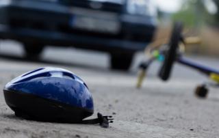 Driver hitting biker on the street horizontal